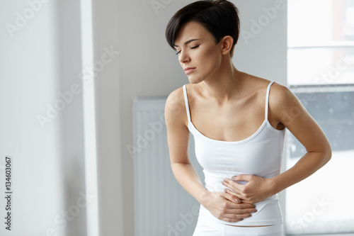 Pain In Stomach. Beautiful Woman Feeling Abdominal Pain. Health