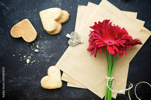 Poster  Valentine's cookies  with coffee, envelopes and flowers on texture background,