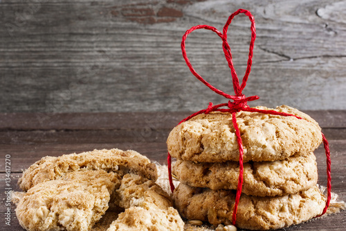 Poster cookies for Valentine's Day with red heart shaped ribbon