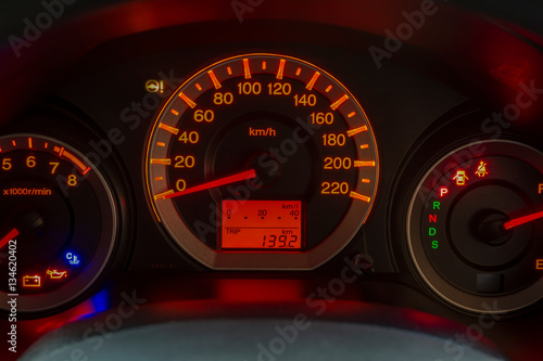 Closeup of a tachometer and speedometer on a sports car dashboard Poster