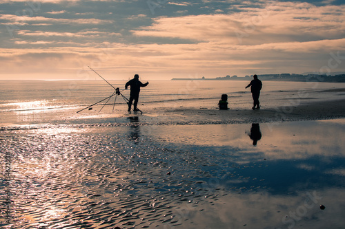 Poster Silhouettes of two fishermen in Pevensey Bay, East Sussex