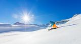 Freerider skier running downhill
