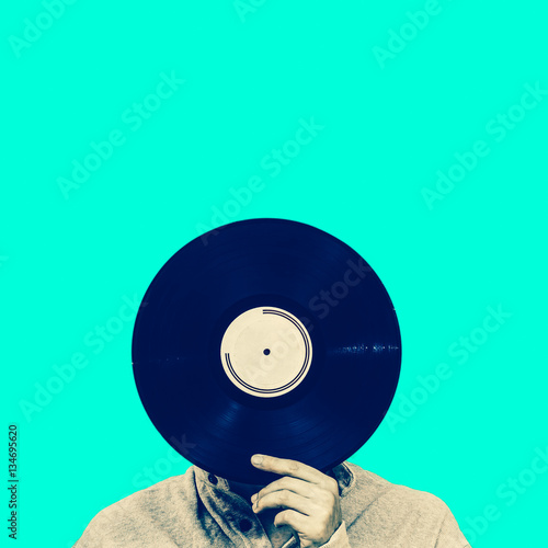 man holding record, isolated on green Poster