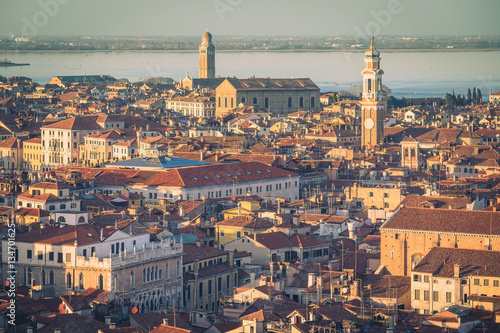 Staande foto Rome Aerial view of Venice, Italy, at sunset with rooftops of buildings and vintage colors in winter afternoon.