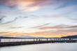 scene of walk way on the lake when sunset.