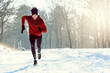 Sportsman Running in Extreme Snow Conditions. Intensive Training Outdoors.