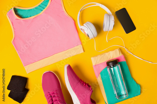 Valokuva Fitness accessories on a yellow background
