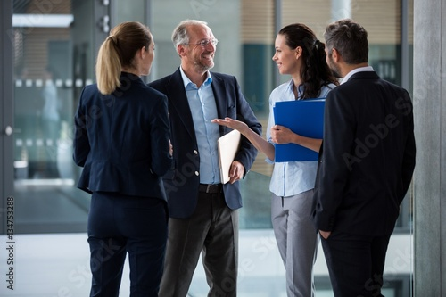 Happy businesspeople having a conversation