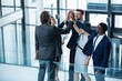 Businesspeople giving high five to each other