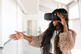 African American Businesswoman Using Virtual Reality Glasses