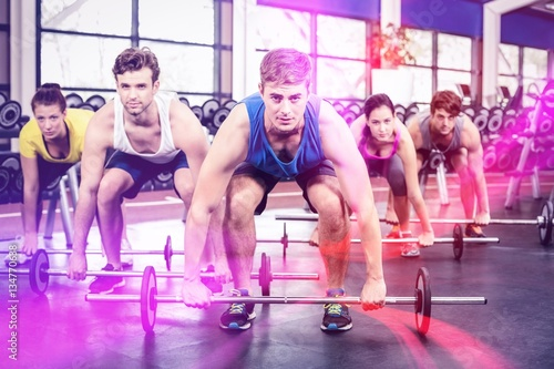 Valokuva Portrait of athletic men and women working out
