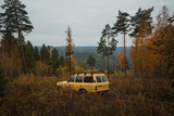 Old Toyota Land Cruiser in the pine siberian forest