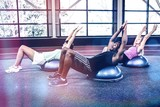 Fit people doing exercise with bosu ball