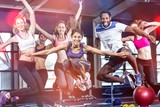 Fototapety Fit group smiling and jumping
