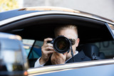 Man Photographing With SLR Camera - 134787045