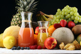 Apple and orange juice -several bottles with fruit and berry juices, vintage wooden background, selective focus