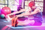 Man and woman performing fitness exercise
