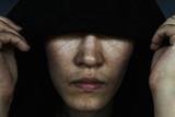 depress woman in hood with tear