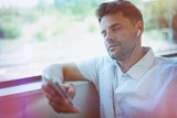 Handsome man with closed eyes listening music on mobile phone