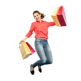 smiling young woman with shopping bags jumping