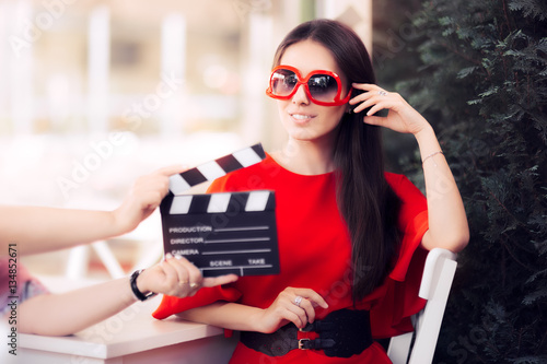 Happy Actress with Oversized Sunglasses Shooting Movie Scene
