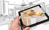 Hand of Architect on Computer Tablet Showing Photo of Kitchen Drawing Behind.