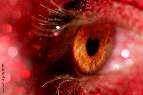 Eye closeup with iris in the shape of a heart Poster