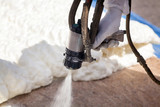 Technician spraying foam insulation using Plural Component Spray Gun - 134888435
