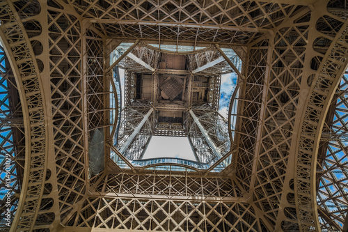 Partial view underneath the Eiffel Tower in Paris, France Photo by kwphotog