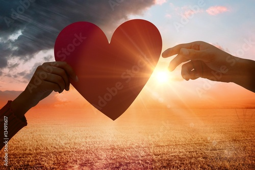 Valokuva Composite image of couple holding a heart