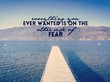 Inspirational quote on lake with pier