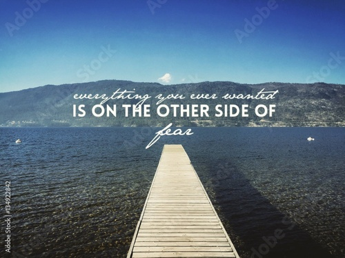 Inspirational quote on lake with pier Photo by Joanne