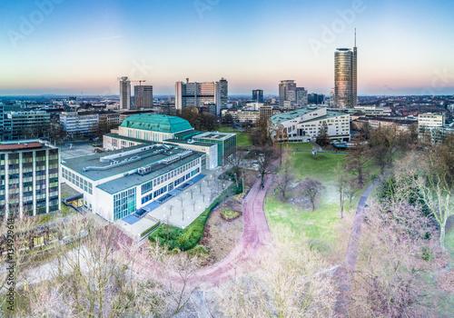Leinwanddruck Bild The city skyline of Essen with the municipal garden