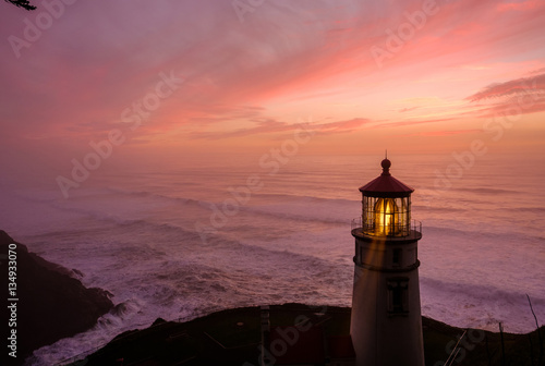 Fotobehang Koraal Heceta Head Lighthouse at sunset, built in 1892