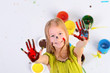 Quadro little blond girl draws a colored paint
