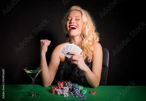 Woman wining a poker game плакат