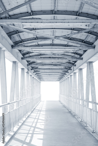 Light from the way out of modern metal structure bridge