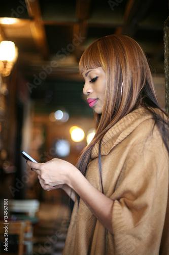 Beautiful African woman using mobile phone.