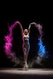 Fototapety Graceful girl posing in cloud of color dust