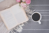 Fototapety relax coffee cup of hot drink and read a book on gray carpet.
