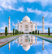 Amazing view on the Taj Mahal in sun light with reflection in water