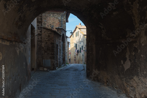 Hidden streets and corners of the arches in Montalcino, Tuscany.