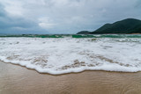 beach sea sky and mountain