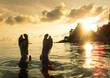 Naked human barefeet at secret beach during sunset in Koh Lipe - Wanderlust travel concept with wonderful South East Asia destination in Thailand - Soft detailed focus for backlight waterproof camera
