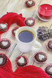 Homemade chocolate cupcakes with hearts and a Cup of coffee for Breakfast. Selective focus. Wooden background.