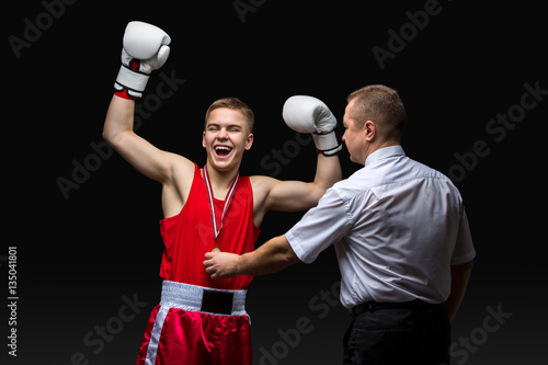 Poster Boxing referee gives medal to young boxer