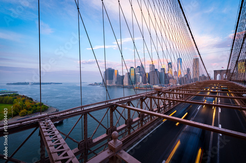 Traffic on the Brooklyn Bridge in New York. Blurred cars driving from Lower Manhattan.