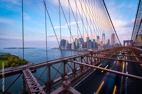 Foto op Canvas Brooklyn Bridge Traffic on the Brooklyn Bridge in New York. Blurred cars driving from Lower Manhattan.