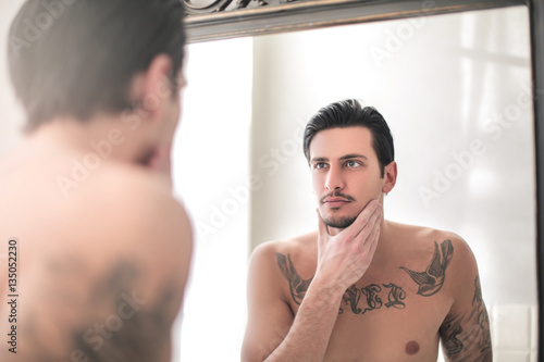 handsome man looking himself in the mirror buy photos ap images