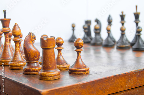Poster Old chess Board with wooden pieces on a white background.